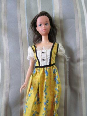 #3 She has non-bendable legs but is marked Mattel