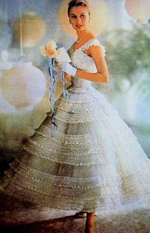 This photo from a 1957 ad in a woman's magazine, shows the inspiration for this ensemble.  It was one of the styles of the late 1950s.