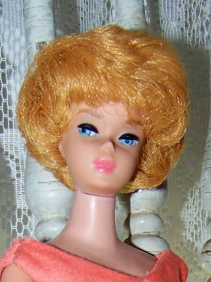 Barbie with Coral lips marked Barbie (R)pats pend (C)with all the letters and numerals by Mattel inc