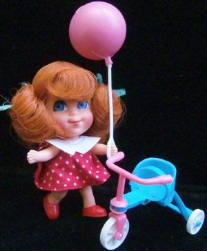 Trikey Triddle wearing  Red Polka Dot Dress